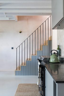 Kitchen and stairs featuring polished concrete