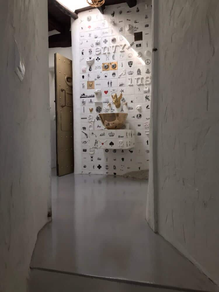Ink House feature wall with rustic polished concrete