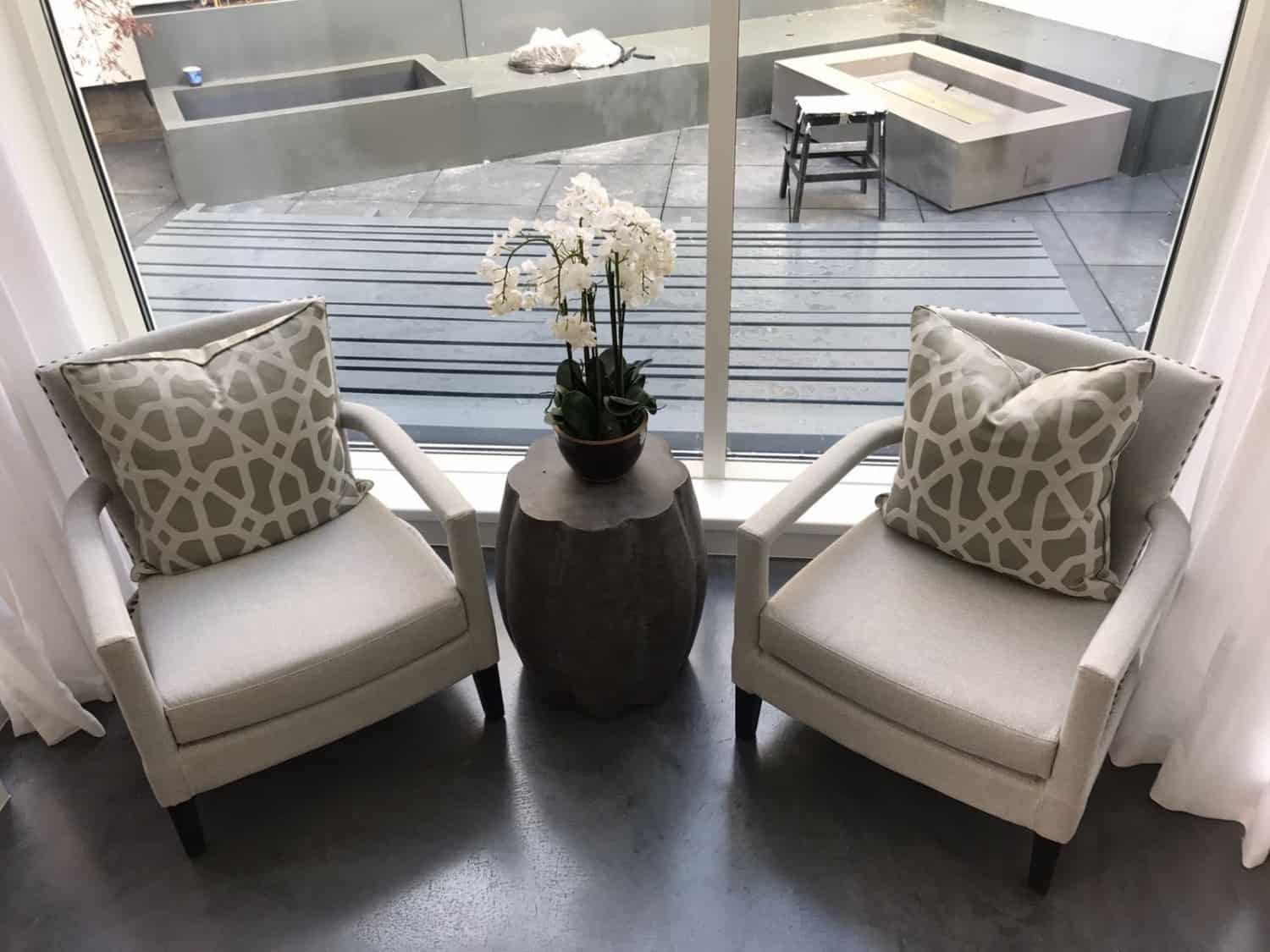 Dark polished concrete floor with two chairs