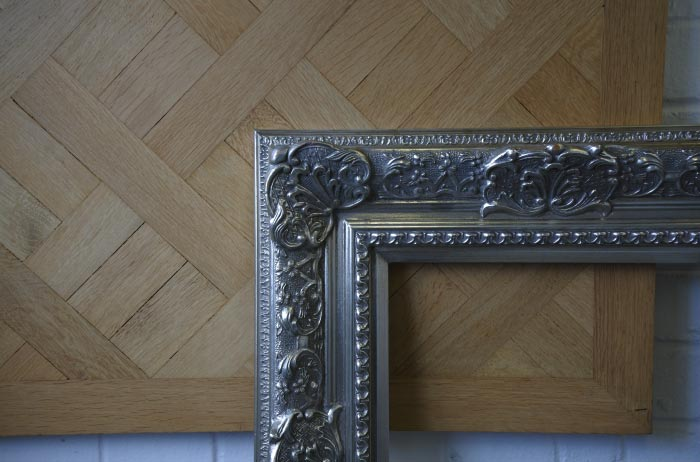 Close up of picture frame on wooden floor.