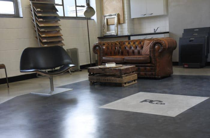View of the polished concrete showroom, with sofa and samples.