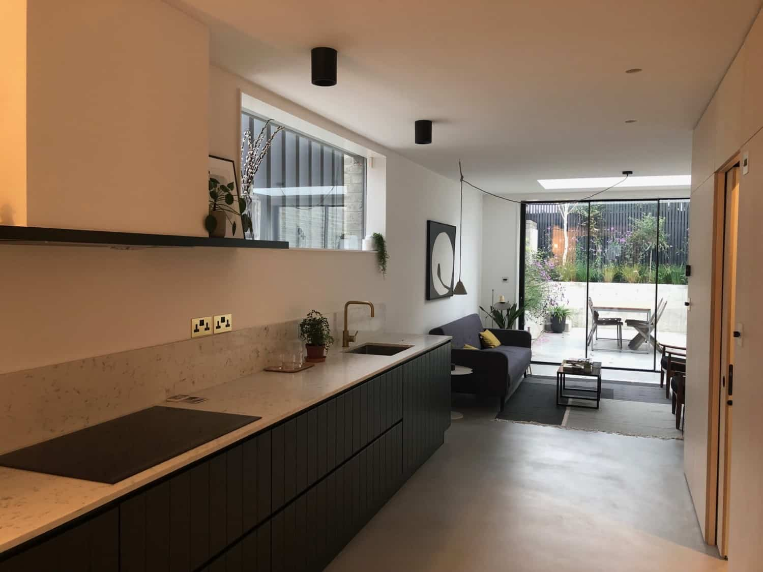 Kitchen with grey cabinets and microtopping floor