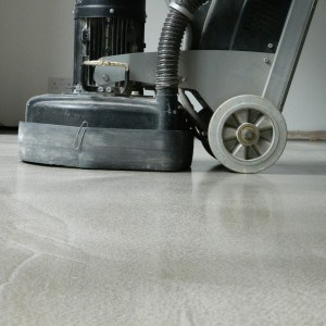 Polishing a polished concrete floor