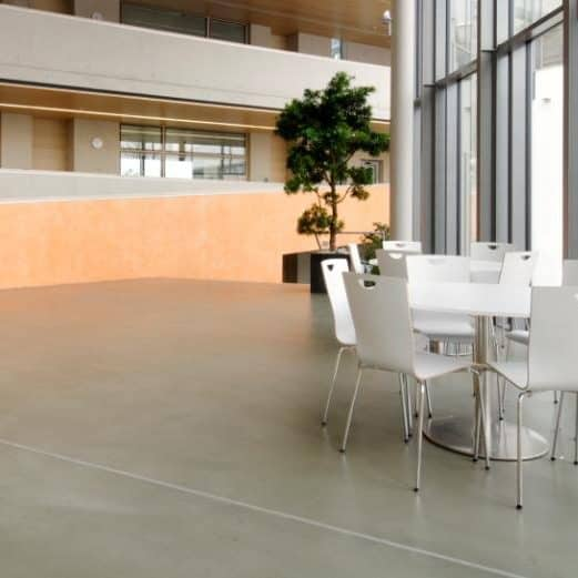 Waiting area with a cement based overlay concrete finish