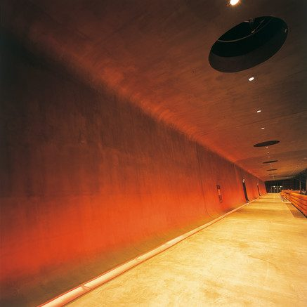 Polished concrete corridor wall, floor and ceiling