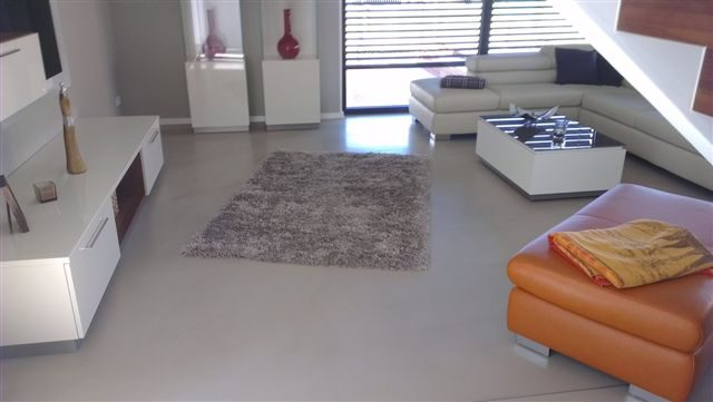 polished concrete floors complete a modern interior design living room