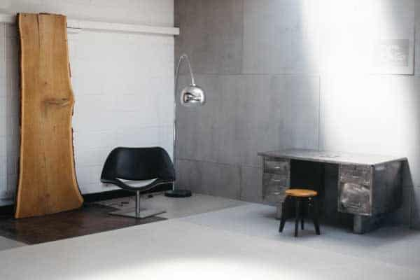 Image of polished concrete showroom., containing a desk roomset.